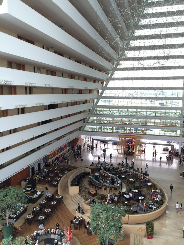 A view of a part of the Marina Bay Sands hotel lobby from above.