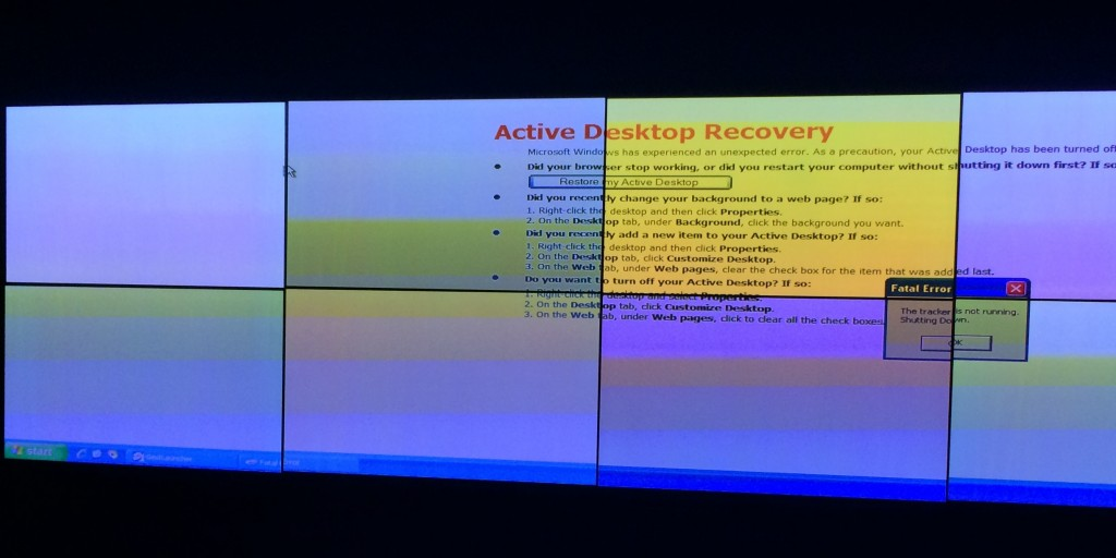 A fatal error on the W Atlanta Midtown's entrance display causing the Active Desktop Recovery Windows XP wallpaper to display.